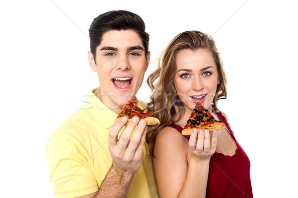 Paar poseren pizza slice jongen meisje Stockfoto © stockyimages
