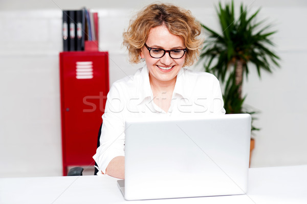 Beautiful woman working in labtop Stock photo © stockyimages