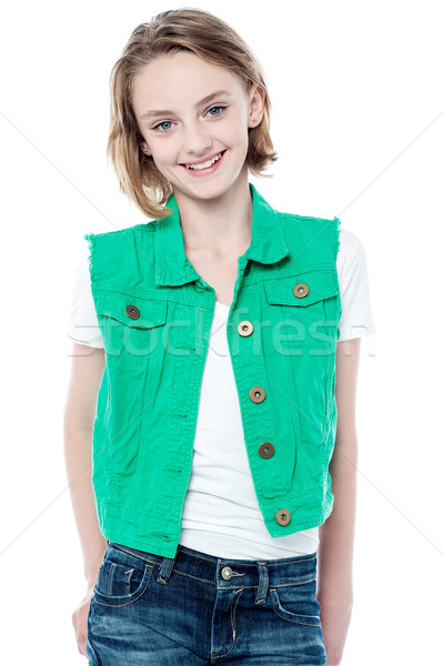 Pretty girl in trendy clothes over white Stock photo © stockyimages