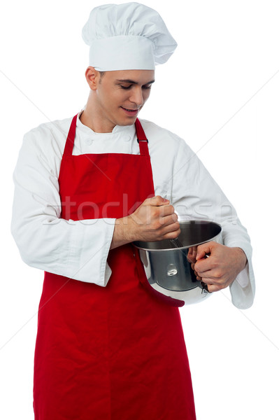 Male chef with whisk and mixing bowl Stock photo © stockyimages