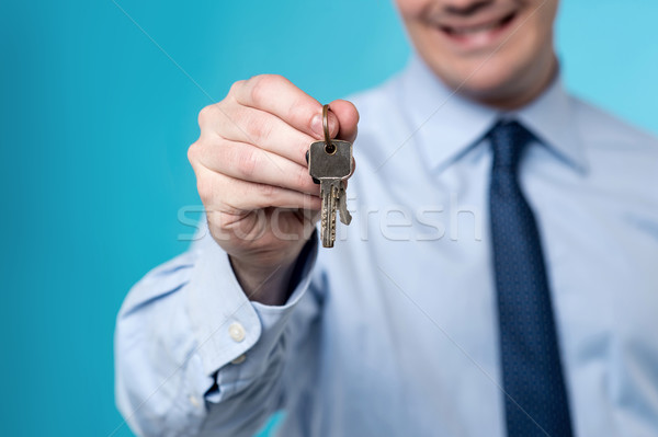 Realtor giving the keys to home Stock photo © stockyimages