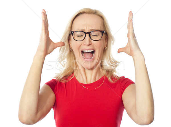 Frustrated aged woman shouting Stock photo © stockyimages