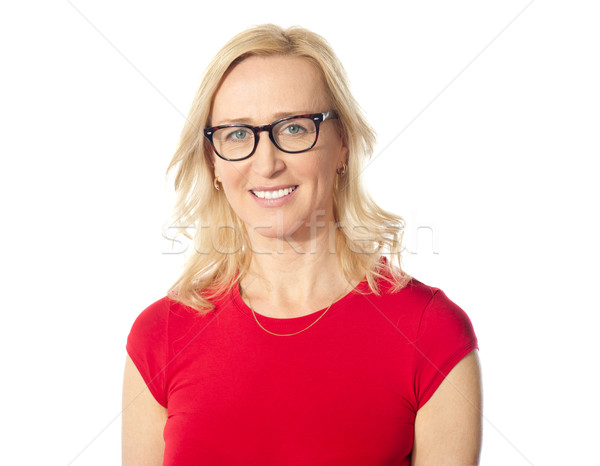 Smiling aged beautiful lady posing with eyewear Stock photo © stockyimages