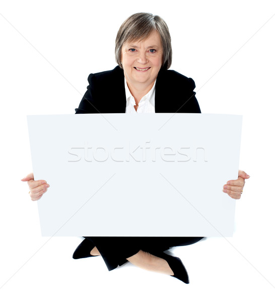 Corporate lady sitting on floor with a blank billboard Stock photo © stockyimages