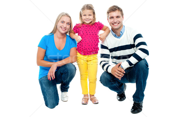 Studio portrait of charming young family Stock photo © stockyimages