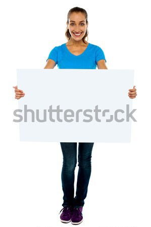 Trendy woman displaying blank billboard Stock photo © stockyimages