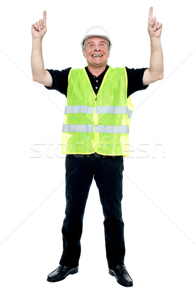 Experienced construction employee pointing his fingers upwards Stock photo © stockyimages