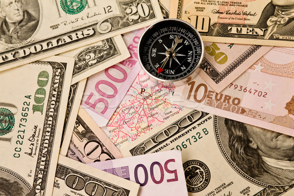 Background of money and compass Stock photo © stokato