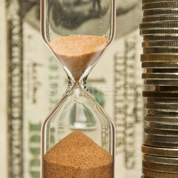Time - money; hourglass on the background money. Stock photo © stokato