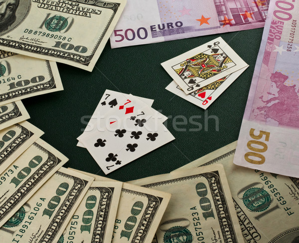 Stock photo: Playing cards on  dollar and euro
