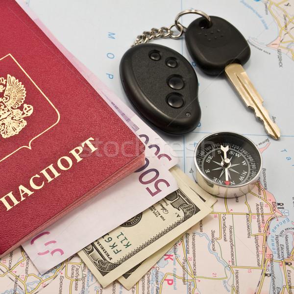 Passport with money, map,Car key, keychain,compas Stock photo © stokato