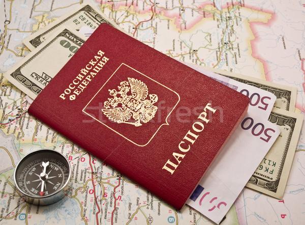 Passport with money and compass on  map Stock photo © stokato