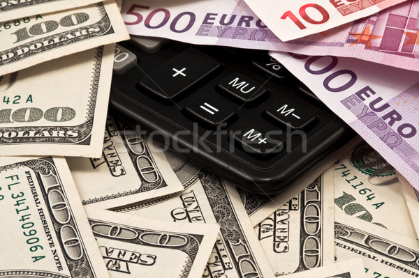 Dollars, euro and calculator  Stock photo © stokato