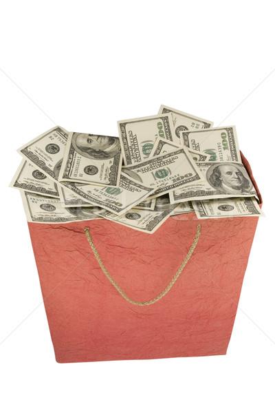 Money in a red Shopping Bag.  Stock photo © stokato