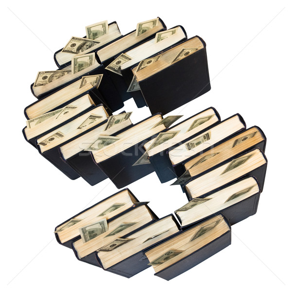 Stock photo:  Dollars in books in form of dollar