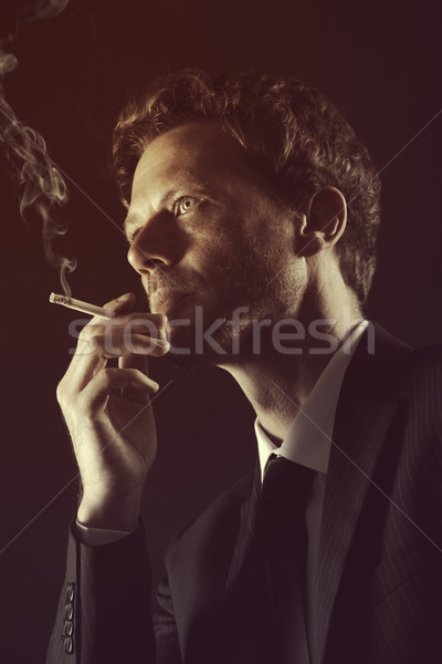 Fumer cigarette homme mûr gens d'affaires costume portrait Photo stock © stokkete