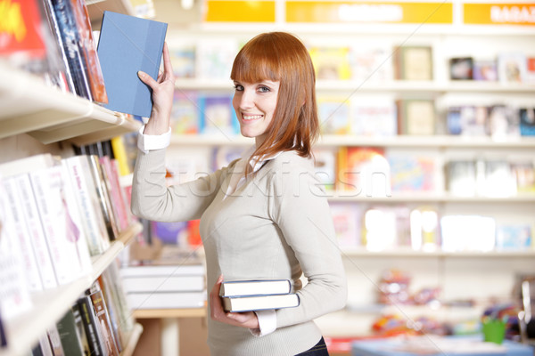 young woman looking for a book in a bookstore  Stock photo © stokkete