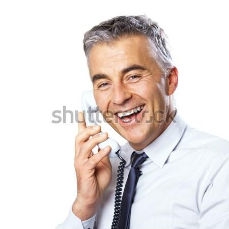Mosolyog üzletember telefon vonzó beszél fehér Stock fotó © stokkete