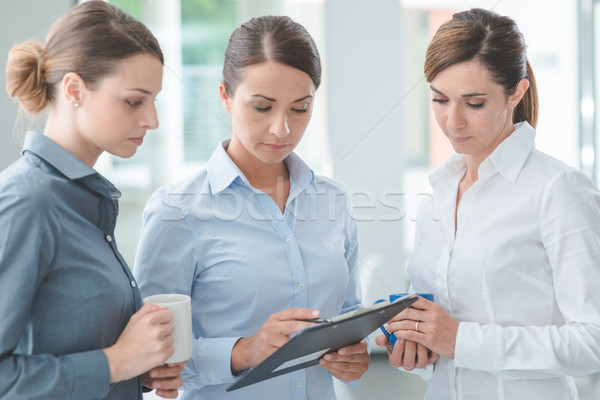 Business women discussing during a coffee break Stock photo © stokkete