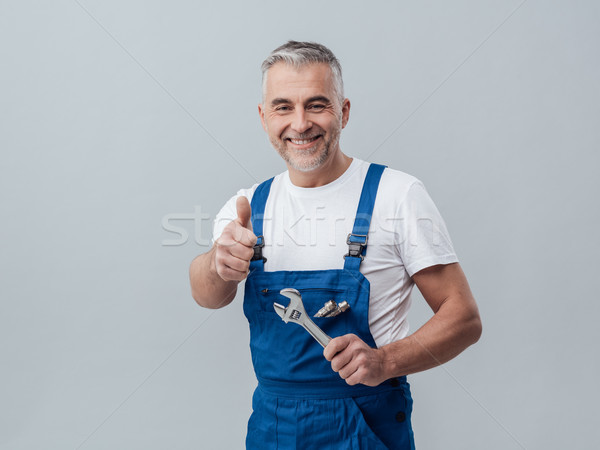 Cheerful repairman Stock photo © stokkete