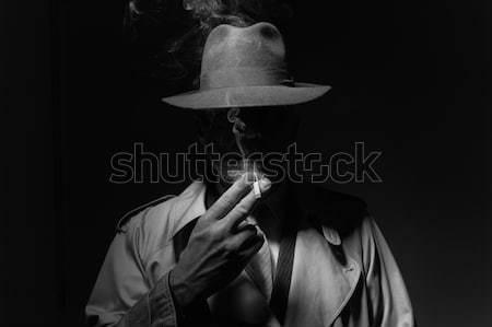 Noir film character smoking a cigarette Stock photo © stokkete