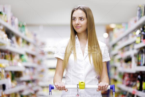 Beautiful Blonde at the supermarket Stock photo © stokkete