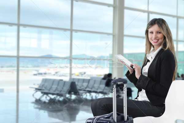 Businesswoman using tablet computer at departure lounge Stock photo © stokkete