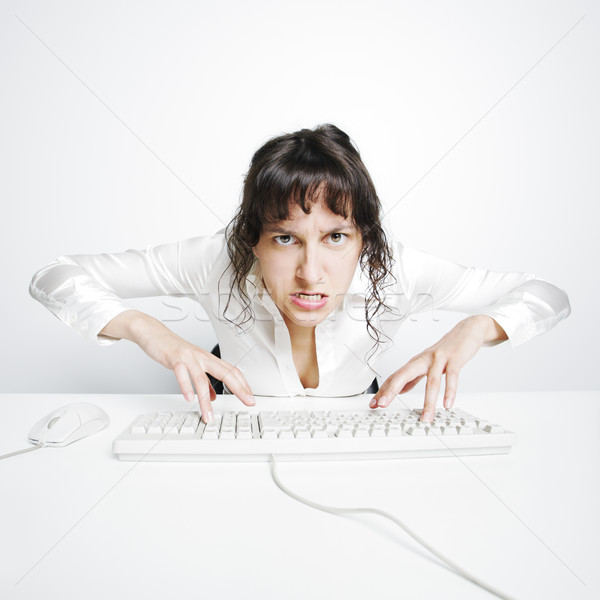 Stock photo: Female secretary crazed from overwork