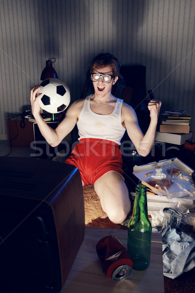 Soccer Fan Watching Television Stock photo © stokkete