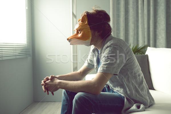 Férfi róka maszk fiatalember visel ül Stock fotó © stokkete