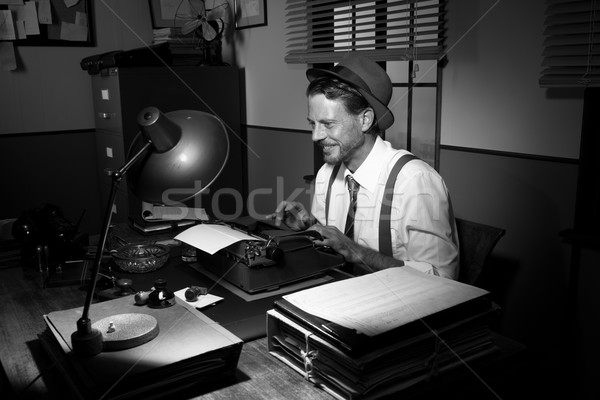 Stock photo: Smiling retro reporter at work