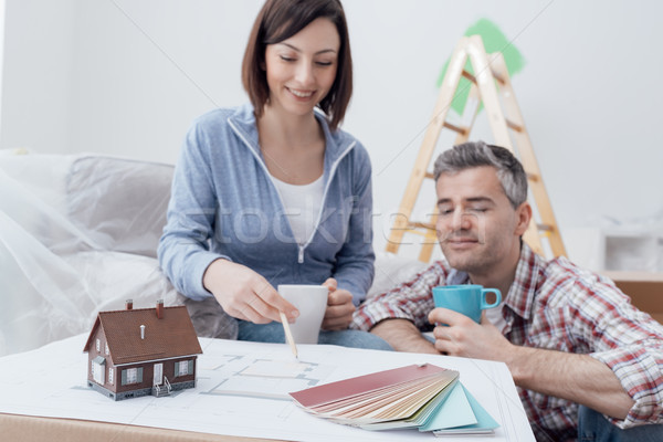 Couple designing their deam house Stock photo © stokkete