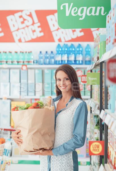 Woman buying healthy food Stock photo © stokkete