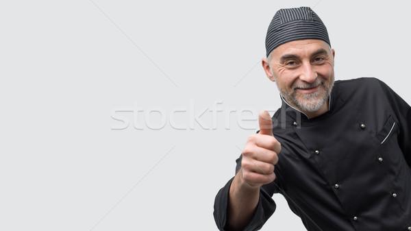 Geslaagd chef volwassen poseren naar Stockfoto © stokkete