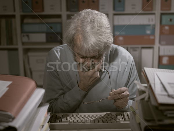 Office worker using a keyboard Stock photo © stokkete