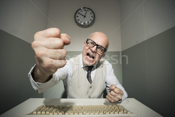 Angry office worker yelling at computer Stock photo © stokkete