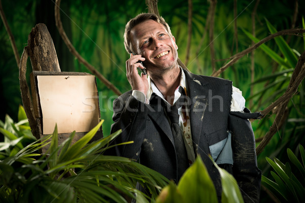 Telefonema sorridente empresário selva vazio Foto stock © stokkete