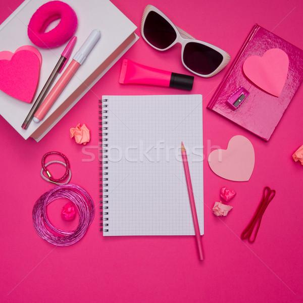 Rózsaszín asztali irodaszer notebook ceruza diák Stock fotó © stokkete