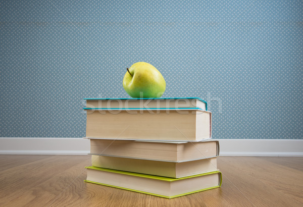 Textbook with yellow apple Stock photo © stokkete
