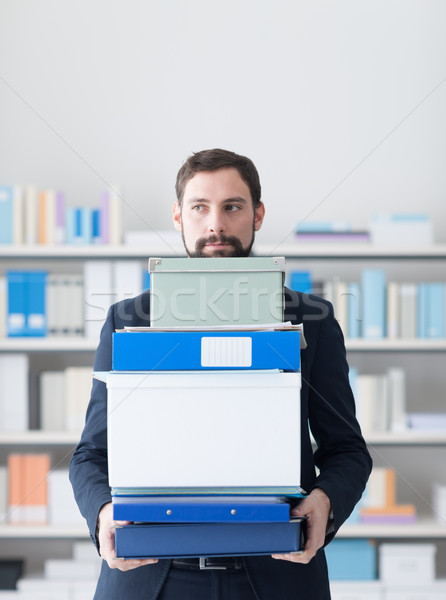 Disappointed businessman carrying boxes Stock photo © stokkete