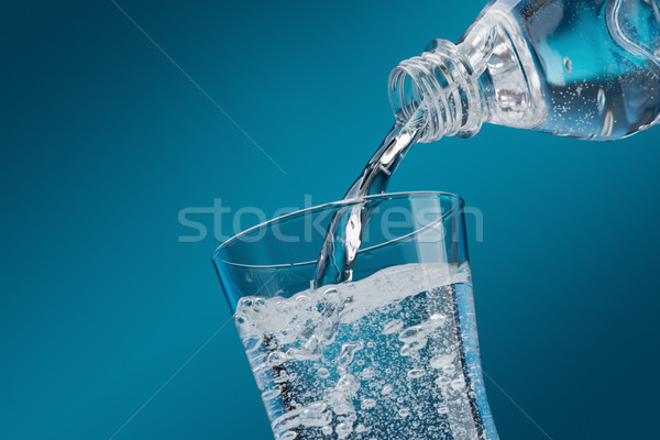 Pouring fresh water into a glass Stock photo © stokkete