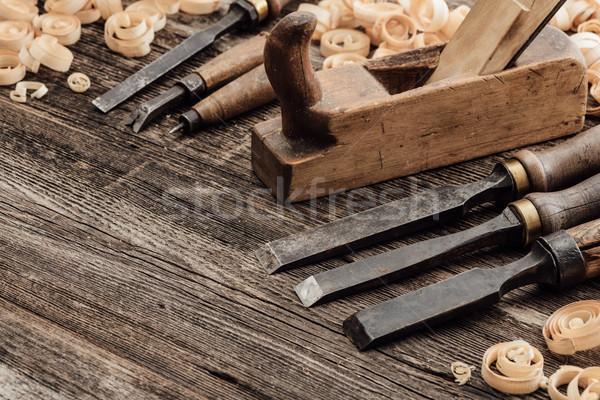 öreg szerszámok fa klasszikus ácsmesterség építkezés Stock fotó © stokkete