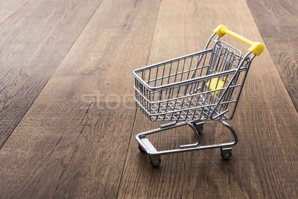 Miniature shopping cart on a desk Stock photo © stokkete