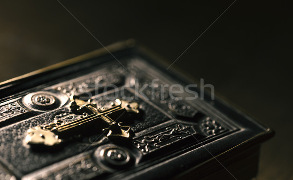 Precious antique Bible with golden cross close up Stock photo © stokkete