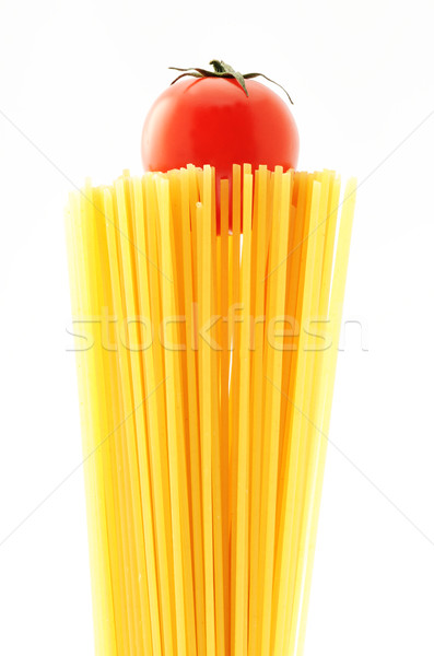uncooked spaghetti noodles . Italian pasta with tomatoes Stock photo © stokkete