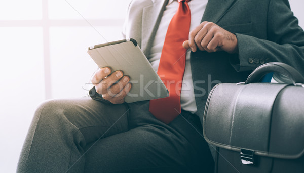 Businessman using a digital tablet Stock photo © stokkete
