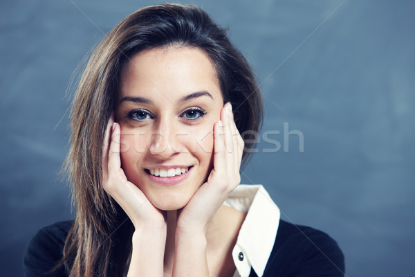 Close-up of a young woman smiling  Stock photo © stokkete