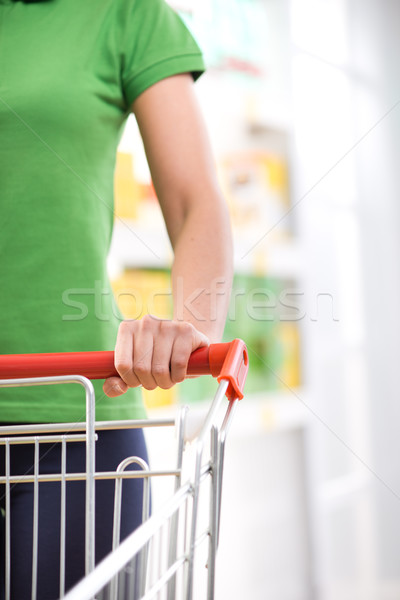 Woman with shopping cart Stock photo © stokkete