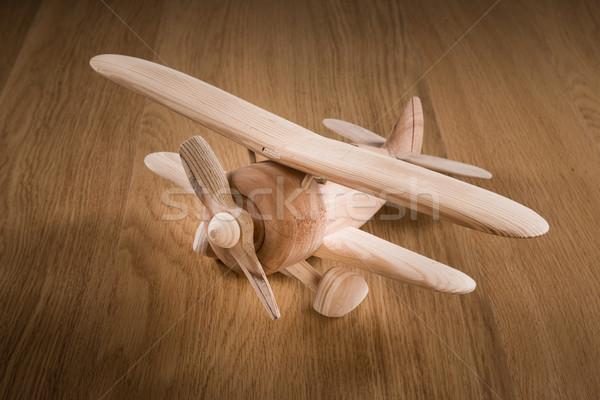 Houten speelgoed vliegtuig hand model onderwijs Stockfoto © stokkete