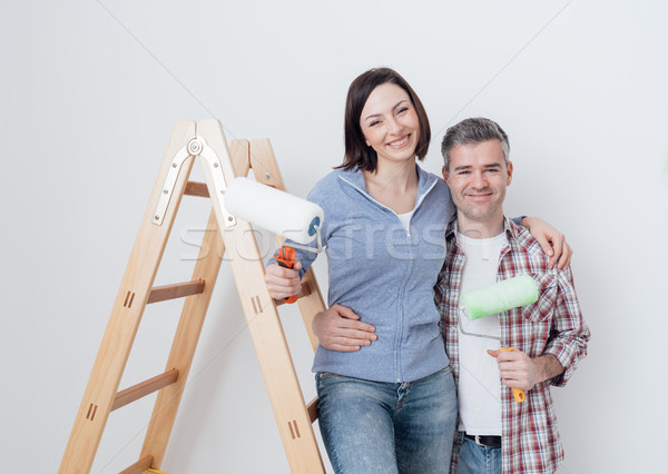 Happy couple renovating their home Stock photo © stokkete